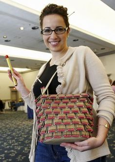 Ginger Allister, who studied fashion design at Cornell on the way to medical school at Brown, with her purse made entirely of matches!