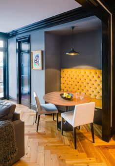small dining nook with round table, yellow and grey Banquette Dining, Dining Nook, Small Space Design, Small Spaces, Contemporary Family Rooms, Contemporary Chairs, Dark Blue Walls, Grey Walls, Dark Grey