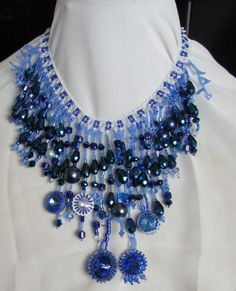 Waterfall necklace with all shades of blue and white beads, pearls, faceted tear drops, seed beads, Swarovski crystal rivolis and more! by SassyBeadedJewelry on Etsy