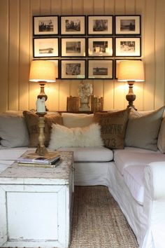 cottage living room. Love the gallery wall and paneled walls.