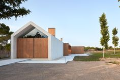 A modern dwelling sits amidst a path of olive trees in the municipality of Fontanars dels Alforins in Valencia, Spain. Architect Ramón Esteve, a Mini...