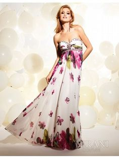 Allure Dresses: Strapless Gown With Floral Pattern: The strapless bustline of this gown by Terani T837 is framed by decorative beading. The full skirt extends from the empire waist, and a large floral pattern adds to the allure of this gown.