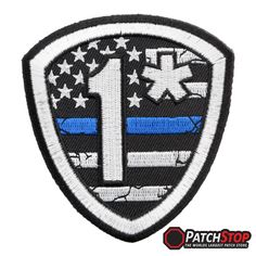 """1* US Flag Thin Blue Line Shield Patch, Law Enforcement Patches - Embroidered shield shaped cut-out patch with a subdued, distressed looking US Flag, """"1*"""" and a thin blue line. This patch measures 3"""" W x 3.25"""" H (7.6cm x 8.3cm)"""