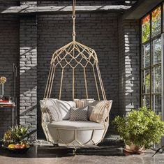 With a luxurious look, this hanging swing is extremely sturdy and comfortable at the same time. Our designer at Mansionly.com used it for a client to enliven the porch area with its simplicity and chicness. www.mansionly.com/ #swing #porch #outdoorliving #outdoor #decor