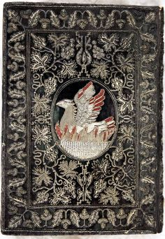 Phoenix in flames from back board of embroidered binding of Holy Bible & Book of Common Prayer (Cambridge,1629).