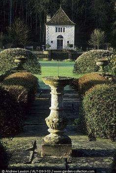 Beautiful garden house, boxwoods, birdbath, everything!