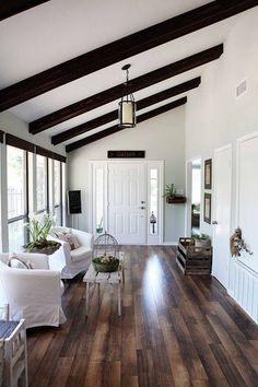 Vaulted ceilings with defined wood beams give this entryway a statement look.
