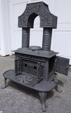 Hoffman Potts Column Parlor Wood Stove, circa may be functional, but to me it is also a work of art.