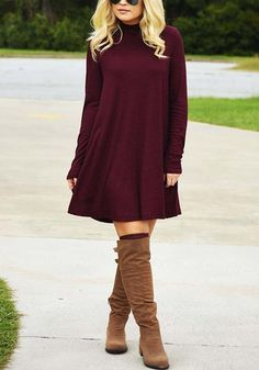 Bust out a '70s vibe with this lovely burgundy mock neck shift dress.
