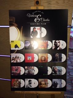 Music themed wedding table plan using CD covers with guest and table names printed onto the CDs.
