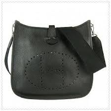 Evelyne III Hermes shoulder bag in ruby taurillon clemence leather ...