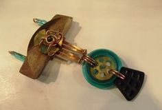 Trashion pendant made completely from recycled items. Found at Wind Water & Light Gallery Urbana, IL