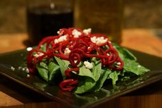 Spinach salad with raw beet curls and blue cheese. Fabulous idea!