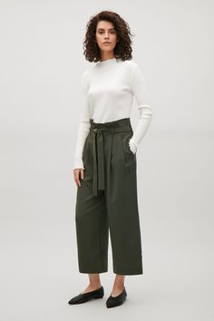 COS of Wide waist pleated trousers in Olive Green and white top with long sleeves.  Stylish casual minimalist outfit | Minimalist casual wear | Capsule wardrobe | Slow fashion | Simple style | Minimalist style | Stylish business casual | Scandinavian casual wear | Stylish work outfit by COS