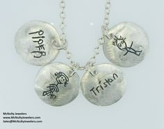 Engraved family necklace. Each charm features a child's original handwriting and artwork.  McNulty Jewelers original design