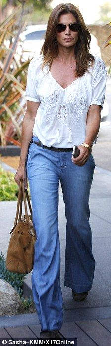 Cindy Crawford /Ageless beauty: The former Cover Girl looked youthful as ever in an embroidered top and seventies-style blue jeans