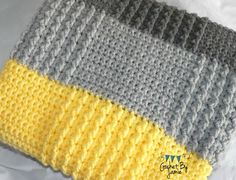 Made to order. Gender neutral crocheted baby blanket. Two shades of gray with a cheery yellow, stripe this sweet blanket. Raised staggered squares