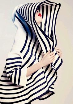 Love the combination of red lipstick with black and white stripes!