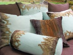 Oh my, that one in the middle is beautiful.  Nature-Inspired Pillow Designs