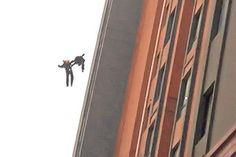 A witness to a fire in Shanghai, China, filmed with his mobile phone incredible scene : Two firefighters fell from the building, and while they were falling they kept hands togheter. They were blasted instantly by an explosion. Sadly they had no chance of surviving because they fell on the sidewalk from a very big height.