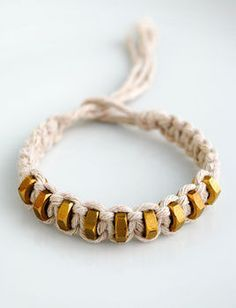 """This bracelet has been inspired by this really wonderful """"Braided Hex-nut Bracelet"""" tutorial which I pinned on Pinterest a while back. Two things I absolutely love about this project are: 1) It's cheap as chips: I already had string in the cupboard and the brass hexnuts were 3p each from the hardware shop. 2) It's my kind of jewellery: I'm not really a girly girl IYKWIM! The bracelet I made is a bit different to the 'braided hex-nut bracelet' and uses macrame instead, which is great, because…"""