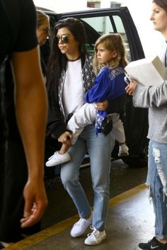Kourtney Kardashian wearing Vans Core Classics