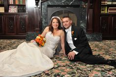 bride and groom all cozy next to this beautiful fire place east wind in wading river ny