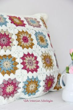 Very pretty granny square  cushion cover.
