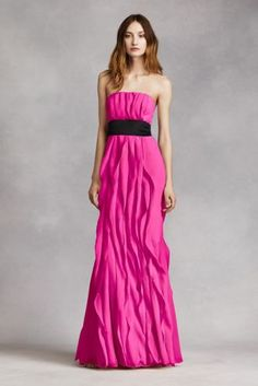 Long bridesmaid dress features gorgeous soft, flowing flangedetail and flattering sash.   Long, soft, strapless dress features beautiful bias cut flanges.  Black Mikado sash is included. Or make the look your own with a White by Vera Wang floral, grosgrain or horsehair sash.  Fully lined. Center back zip. Dry clean only. Imported.