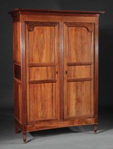 Transitional Louis XV-XVI armoire made in the West Indies, 18th century, mixed tropical woods. To be sold at Neal Auction, New Orleans, LA—Nov 17–19, 2017.