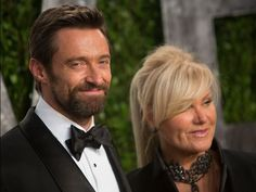 Best-actor nominee Hugh Jackman and his wife, Deborra-Lee Furness, pose in front of the 'VF' wall of foliage. Adrian Sanchez-Gonzalez, AFP/Getty Images