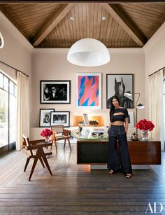 In her home office, Kourtney Kardashian has arranged mixed-media artworks in varying displays, from classic black-and-white photography leaned against the wall to a vibrant work on paper by Bridget Riley hung above the fireplace.
