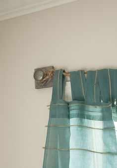 We love these DIY curtain rods made from rope. The project cleverly uses cabinet knobs to attach the rope curtain rods to the wall. See the tutorial on The Home Depot Blog.