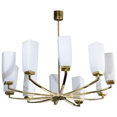 Hotel Style chandelier in brass and opaque glass