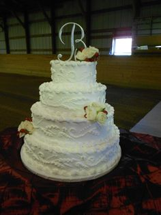This is a gorgeous four tier cake with scroll piping and a buttercream flat ice!