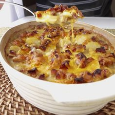 Scalloped potatoes with kielbasa - deliciously creamy scalloped potatoes kicked up a notch with sweet smokey meat.
