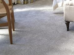 Wall-to-wall Stainmaster TruSoft Rising Star nylon carpet from Lowe's in a subtle gray, similar to the wall color $3.38