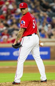 Texas Rangers relief pitcher Matt Bush (51) looks over his shoulder at first base during the eighth inning of their game against the Los Angeles Angels on Tuesday, May 24, 2016 at Globe Life Park in Arlington, Texas. (Ashley Landis/The Dallas Morning News)