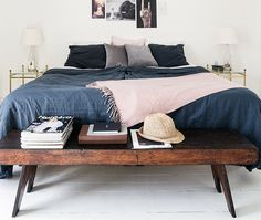 Love the combination of dark blue and pink bedding in this simplistic bedroom set up