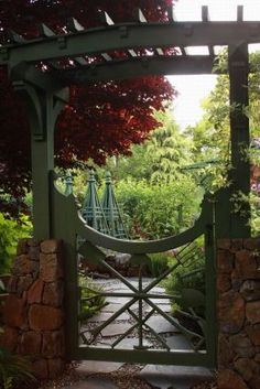 Freeland Tanner created this gate from garden tools to welcome visitors to his enclosed vegetable garden.--Click through to read more about this garden!