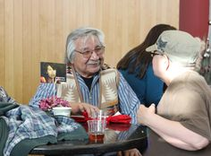 Opening Reception: Myron Longsoldier, featured in Honoring the Spirit of Life enjoys hors d'oeuvers from Chez Hay Catering while chatting to a friend #VMFF2014