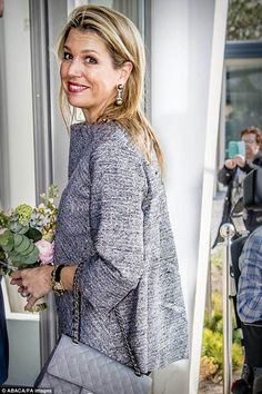 Queen Maxima of the Netherlands looked delighted upon receiving a spring bouquet during a visit toa conference in Zandvoort on Wednesday