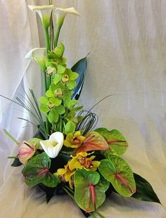 Anthurium, orchids and ti leaves create a gorgeous formal arrangement. The addition of bear grass not only adds interesting texture and a beautiful dark green; it also adds a bit of whimsy. Tropical Flowers, Tropical Flower Arrangements, Church Flower Arrangements, Church Flowers, Silk Flower Arrangements, Funeral Flowers, Exotic Flowers, Fresh Flowers, Beautiful Flowers