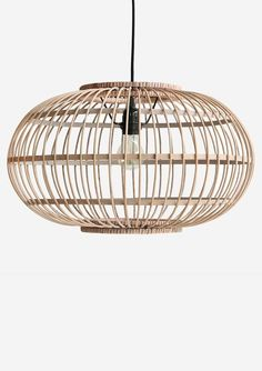 Modern and yet elegant, this Rattan Orb Pendant light shade adds an updated touch to your mid century or traditional décor. -Fits standard light swag kit -Includes: Rattan shade -Hand crafted in Indonesia Bamboo Ceiling, Ceiling Lamp, Ceiling Lights, Orb Pendant Light, Pendant Lamp, Rattan Lampe, Innovation Living, Bamboo Shades, House Doctor