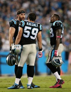 Teammates Jared Allen #69 Luke Kuechly #59 and Thomas Davis #58 of the Carolina Panthers talk during a break against the Philadelphia Eagles at Bank of America Stadium on October 25, 2015 in Charlotte, North Carolina. (Oct. 24, 2015 - Source: Streeter Lecka/Getty Images North America)