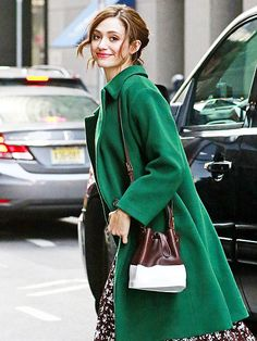 Star Tracks: Friday, March 20, 2015   DRESS FOR SUCCESS   Emmy Rossum takes to the streets of N.Y.C. in a gorgeous green coat and complementary dress on Thursday.