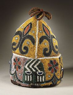 Oba's beaded royal crown from the Yoruba peoples of Nigeria century). Glass beads embroidered on plain weave striped & painted cotton over a metal frame, in high. via LACMA African Crown, African Hats, Orishas Yoruba, Yoruba People, Afrique Art, Saint Laurent, African Textiles, Clothing And Textile, Crown Royal