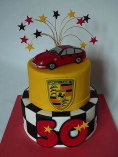Porshe Carrera 911 - A marble cake with chocolate ganache covered with fondant for Jimmy's 50th birthday. He owns a red Porshe Carrera 911 that I reproduced out of fondant. The Porshe logo is edible image.