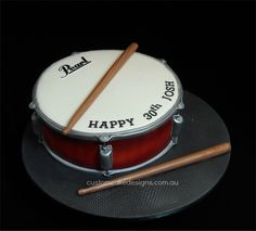"""Pearl Snare Drum - Another musical instrument this week ... This drum cake was made for a 30th birthday bash. Josh's family wanted a Pearl Snare drum that had the Pearl """"Volcano Burst"""" model colouring with some sugar drumsticks."""