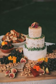 16 Fresh Ideas for a Farm-to-Table Wedding | Forget a sweet cake and bring in CHEESE cake. This is a step above any traditional charcuterie board and what's not to love about this simplistic, yet stunning layout.